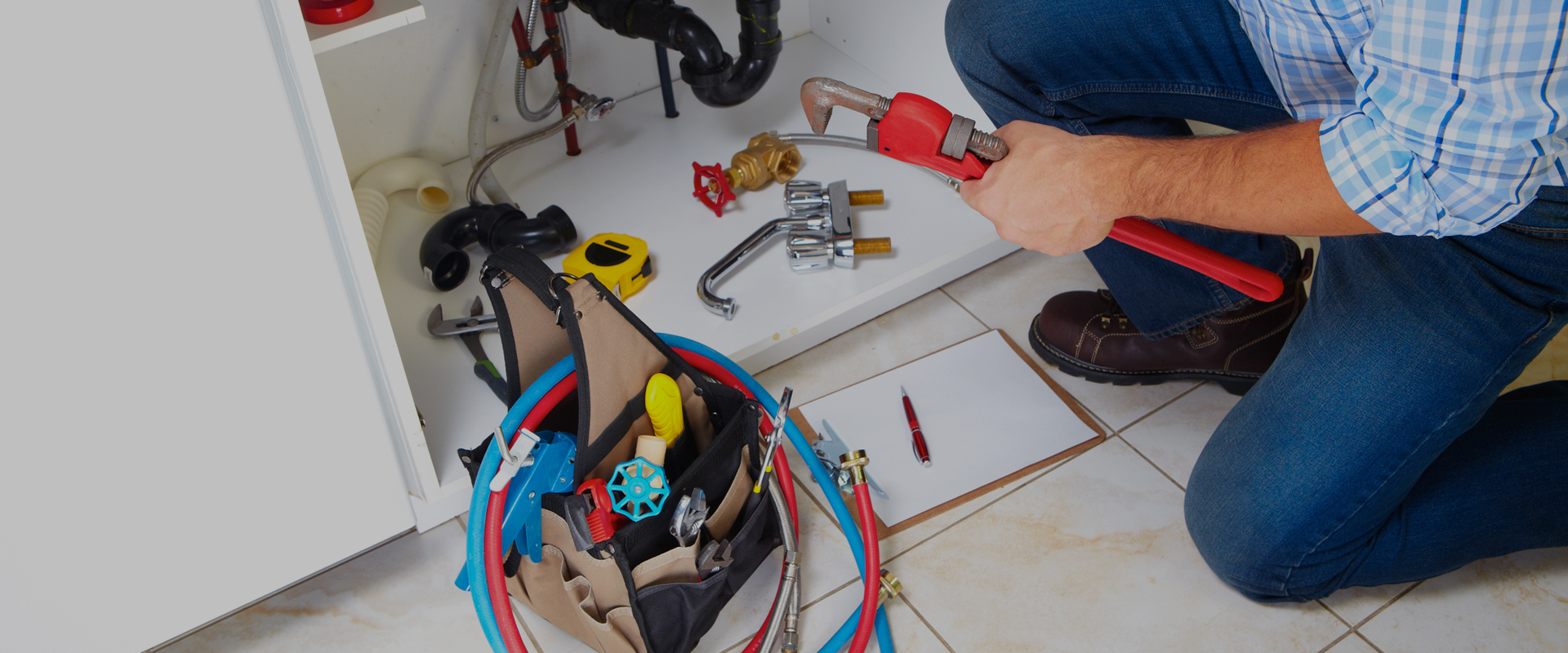 Plumbing Repair Contractor Fixing Sink